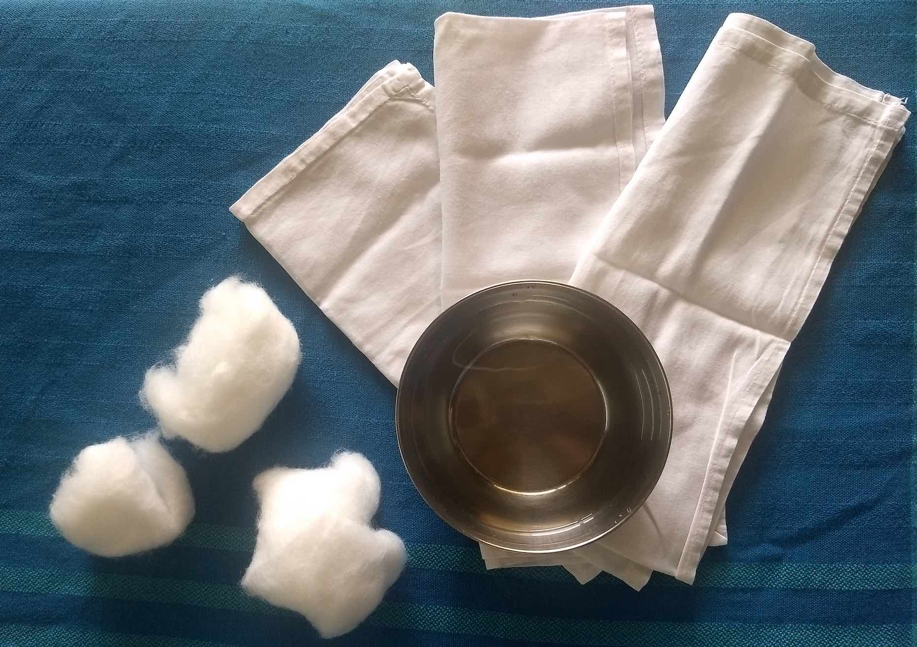 reusable baby wipes; soft muslin napkin; cotton balls with water